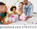 team greeting colleague at office birthday party 37615133