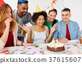 team greeting colleague at office birthday party 37615607