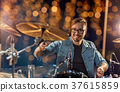 musician or drummer playing drum kit at concert 37615859