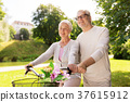 happy senior couple with bicycles at summer park 37615912