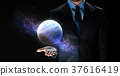 close up of businessman with planet hologram 37616419
