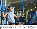 Men exercising in the gym 37618541
