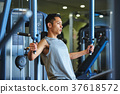 Men exercising in the gym 37618572
