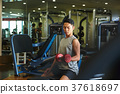 Men exercising in the gym 37618697