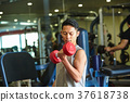 Men exercising in the gym 37618738