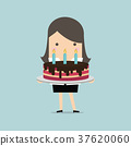 Businesswoman with a big cake 37620060