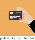 Hand holding credit card 37620342
