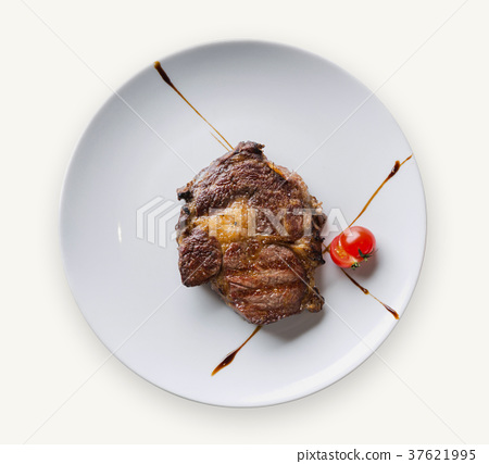 Rib eye steak on white plate closeup 37621995