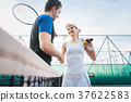 Tennis players shaking hand after match 37622583