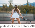 Woman waiting for return playing tennis 37622590