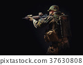 special forces soldier with a rifle is aiming at the target 37630808