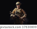 special forces soldier with a helmet is holding a rifle 37630809