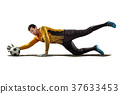 one soccer player goalkeeper man catching ball in 37633453