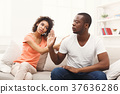 Young black couple making peace after quarreling 37636286