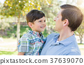 Happy Caucasian Father and Son Playing Together in the Park. 37639070