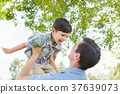 Happy Caucasian Father and Son Playing Together in the Park. 37639073