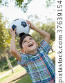 Cute Young Boy Playing with Soccer Ball Outdoors in the Park. 37639154