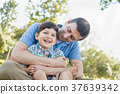 Loving Young Father Tickling Son in the Park. 37639342