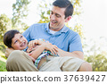 Loving Young Father Tickling Son in the Park. 37639427