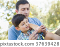 Loving Father Puts a Bandage on the Elbow of His Young Son in th 37639428