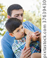 Loving Father Puts a Bandage on the Elbow of His Young Son in th 37639430