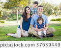 Attractive Young Mixed Race Family Portrait in the Park. 37639449