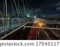 Dusk busy traffic over Brooklyn Bridge 37640317