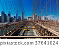 Brooklyn Bridge Traffic with yellow cab and people 37641024