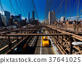 Brooklyn Bridge Traffic with yellow cab and people 37641025
