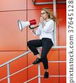 girl, speaker, holding 37645128
