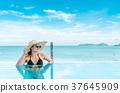 Portrait woman relax luxury pool villa. 37645909