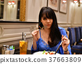 Restaurant Concept. Asian women eating in restaurant. Asian wome 37663809