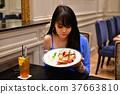 Restaurant Concept. Asian women eating in restaurant. Asian wome 37663810