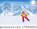 Ski and snow fun. Kids skiing. Child winter sport. 37669850