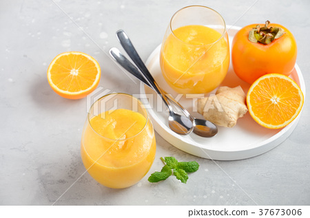 Healthy smoothie with persimmon, orange and ginger 37673006