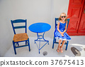 Adorable little girl on vacation in greek village 37675413