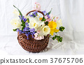 Colorful spring flowers in a wicker basket 37675706