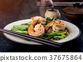 Chinese  broccoli fried with shrimps. 37675864