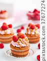 Raspberry and caramel cupcakes on white background 37677274