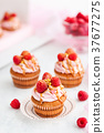 Raspberry and caramel cupcakes on white background 37677275