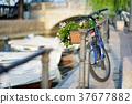 Some bikes parked in small european town 37677882