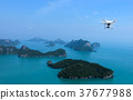 Flying Drone camera in the sky with island views 37677988