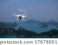 Drone camera in the blue sky with ocean and island 37678001