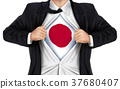 businessman showing Japan flag underneath his shirt 37680407
