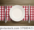 top view of empty plate with spoon and knife 37680421
