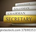 book title of secretary isolated on a wooden table 37690353