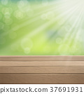 wooden table over green blurred background 37691931