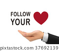 follow your heart words holding by realistic hand 37692139