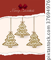 gingerbread cookies hanging over Christmas card 37694976