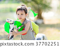 Portrait of Asian girl with backpack playing 37702251